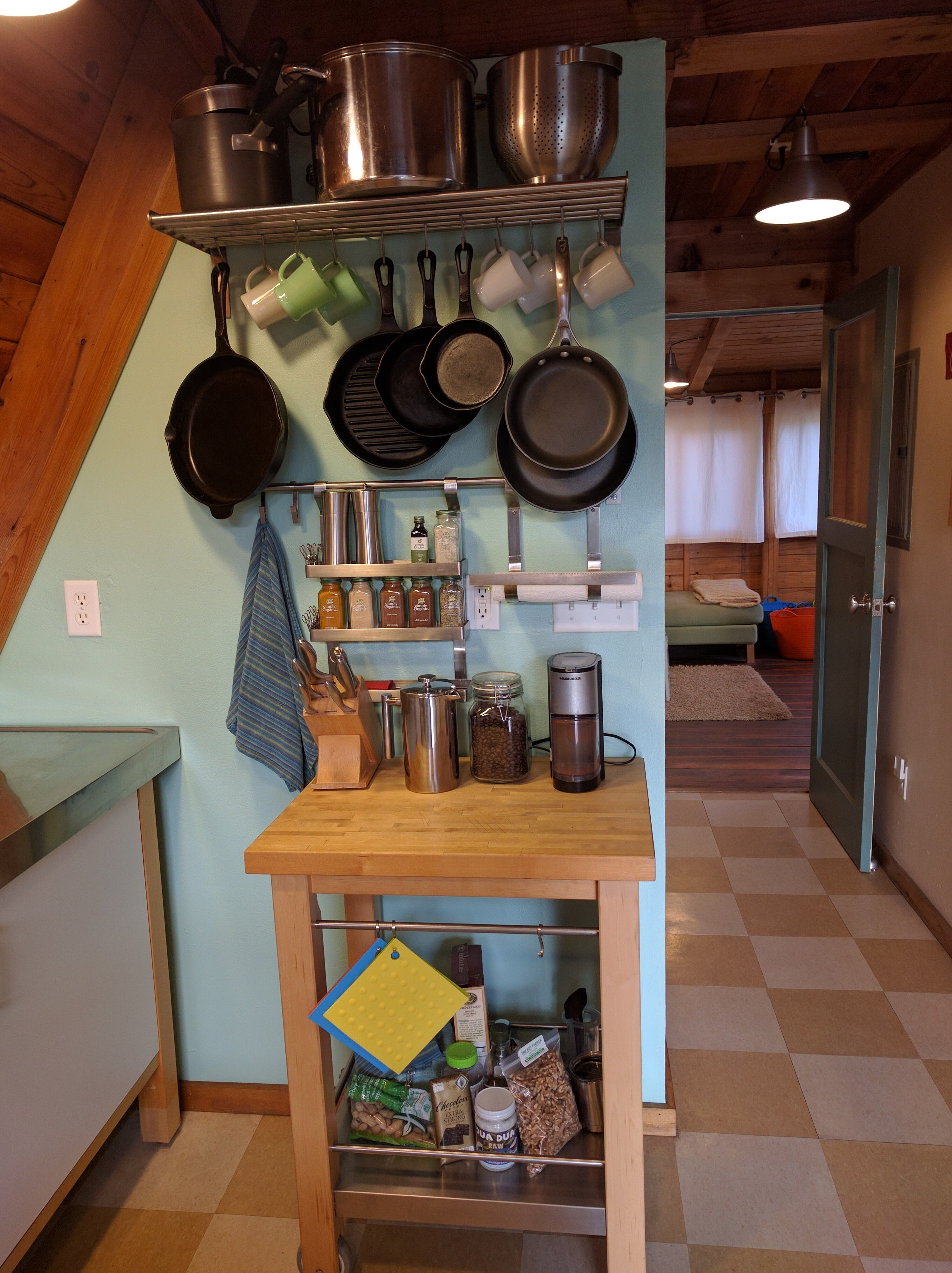 Plenty of cookware including French press coffee and cast iron pans.