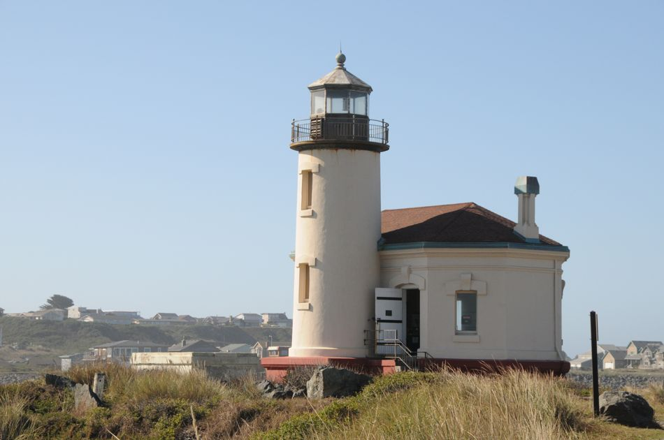 The A-frame is located directly behind the lighthouse across the river.